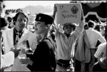 South Africa - worker brings reinforcements at wine tasting party near Paarl in the Cape, 1984 by Ian Berry