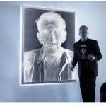 Vanishing Cultures - Dennis next to the 6 ft 4.5 ft negative © Dennis Manarchy