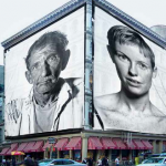 Vanishing Cultures - Vision for hanging the giant photographs on buildings © Dennis Manarchy