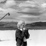"Eve Arnold USA. Nevada. US actress Marilyn MONROE on the Nevada desert going over her lines for a difficult scene she is about to play with Clarke GABLE in the film ""The Misfits"" by John HUSTON. 1960 © Eve Arnold /Magnum Photos"