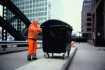 Taking a trashcam picture  Garbageman Hans-Dieter Braatz is taking a picture with a 1.100 litre garbage container transformed into a pinhole camera. It will take 2 minutes of framing and one hour waiting. Picture taken by Mirko Derpmann with a fuji GW690 on Fuji Velvia. © Mirko Derpmann