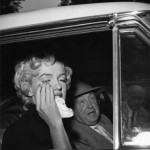 Marilyn and attorney Jerry Geisler driving away after press conference in Hollywood annoucing her divorce from Joe DiMaggio, 1954 © Bruno Bernard / courtesy of 'Marilyn: Intimate Exposures' by Susan Bernard