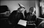 Martine Franck - Tulku Khentrul Lodro Rabsel, 12, with his tutor in a Nepalese monastery, 1996. Photograph: © Martine Franck