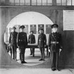 Cecil Beaton - China, 1944: the Chinese assistant chief of police and his staff grouped in a circular doorway at headquarters in Chengdu - © Cecil Beaton/ Imperial War Museum