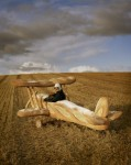 Tim Walker - Rollo Hesketh-Harvey & his baguette biplane Eglingham Hall, Northumberland, 2009 © Tim Walker