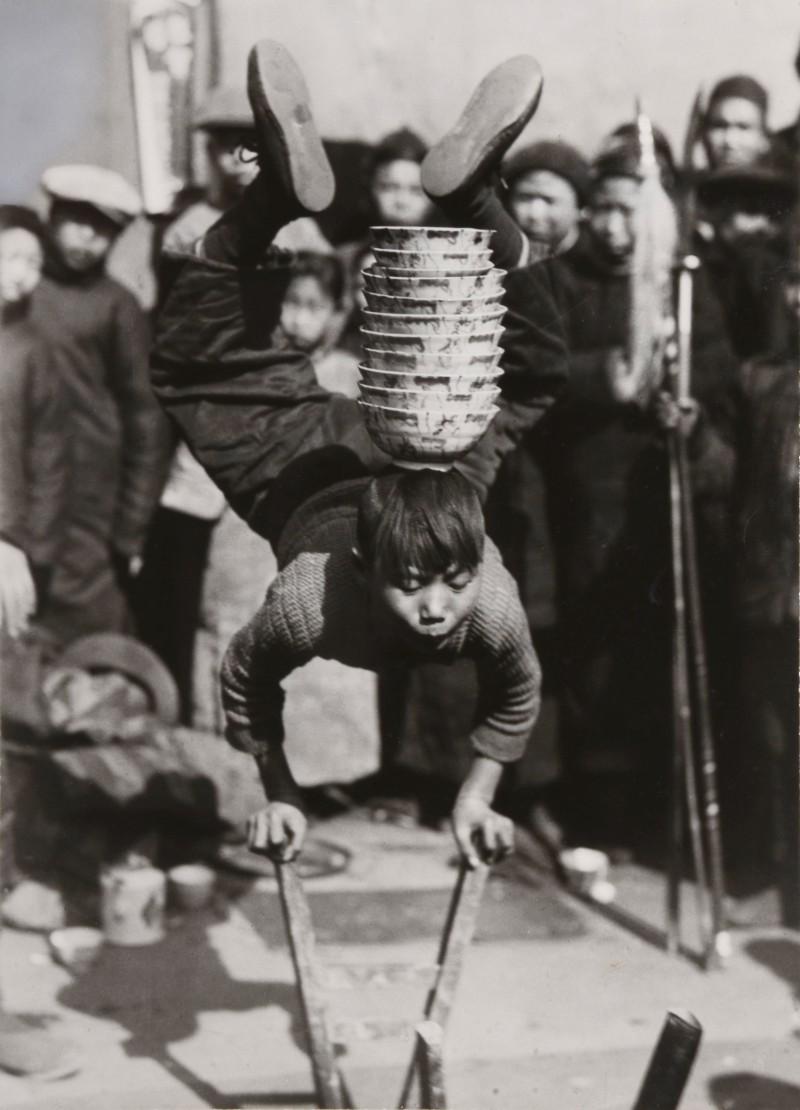 L W Chamberlain - A boy Juggler, Kashing, Chekiang, China, Circa 1929 © L W Chamberlain/National Geographic Magazine
