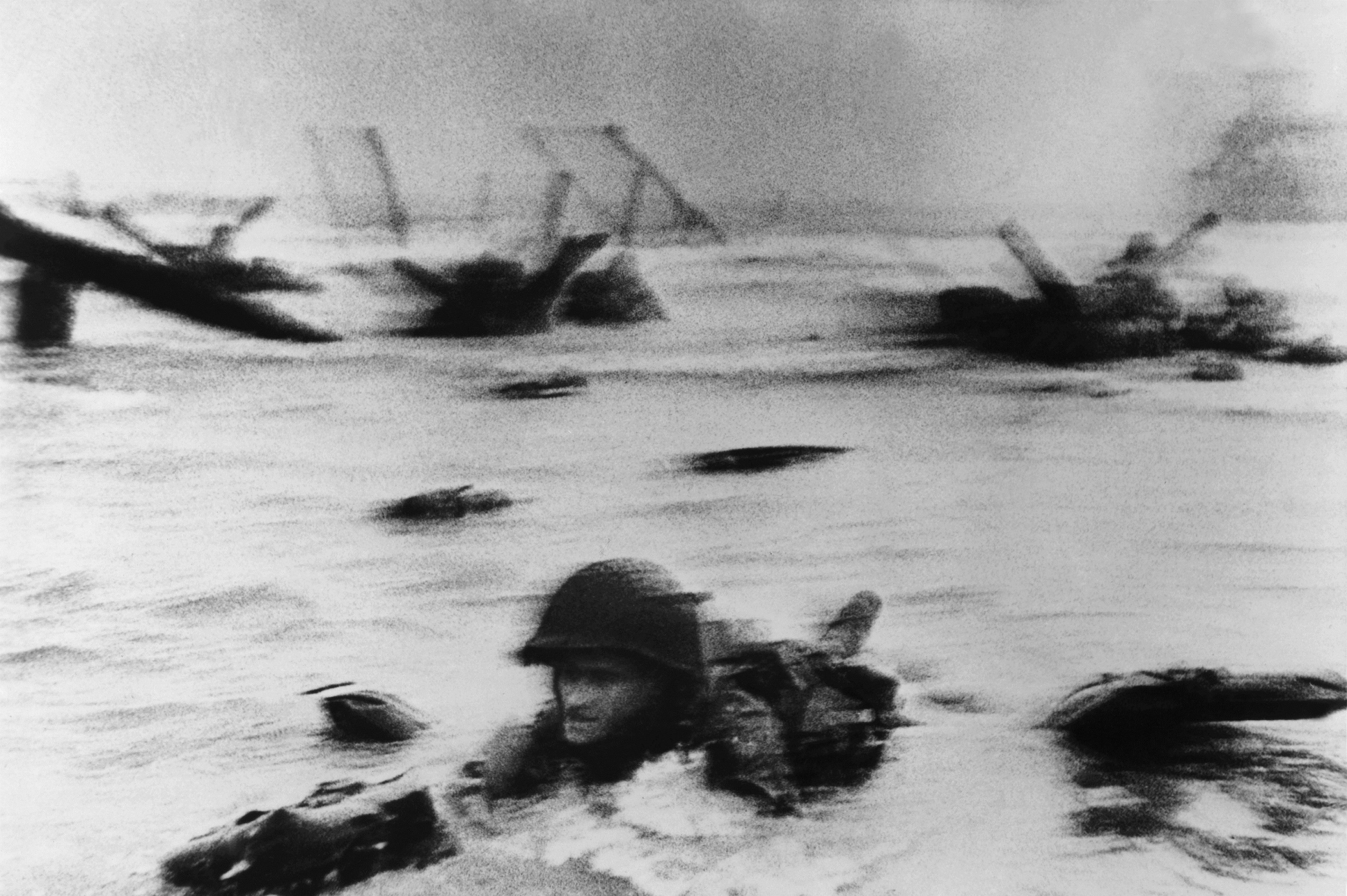 Robert Capa - Landing of the American troops on Omaha Beach, France, 1944 © Robert Capa Courtesy of ATLAS Gallery