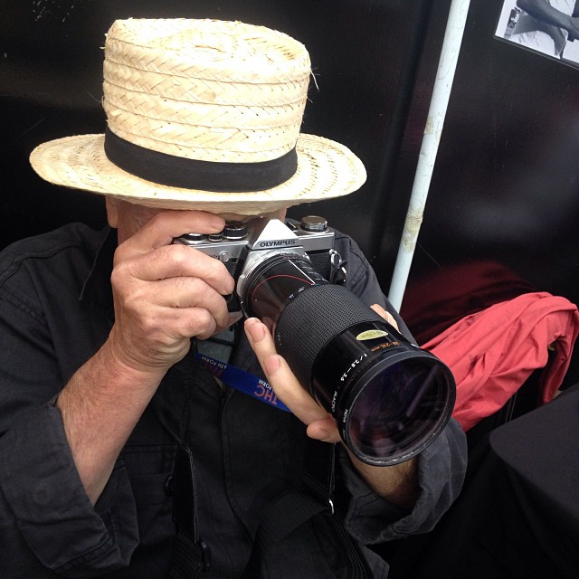 Mike Pitt shooting at the market stall on his trusted OM-2N #Filmsnotdead